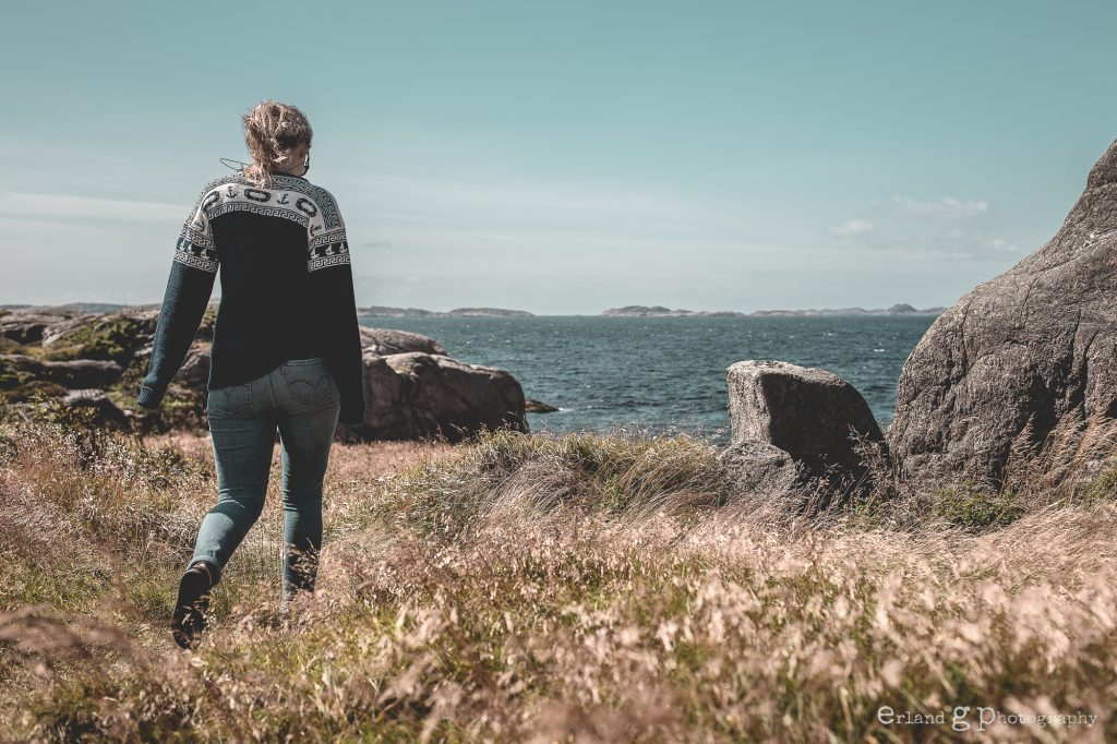 """Woman walking towards """"Daumansbukta"""", in english Dead Mans Bay. This is where  the wind and the currents of the sea made drowned sailors drift ashore in the old days."""